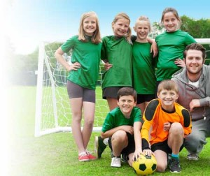 6 person kids soccer team and soccer coach