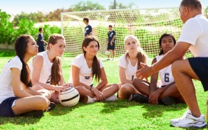 coach talking to his team of competitive pro girls