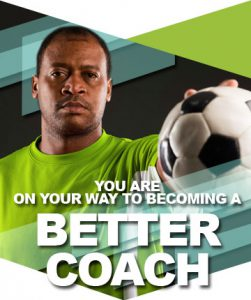African american soccer coach holding a soccer ball. You are on your way to becoming a better coach.